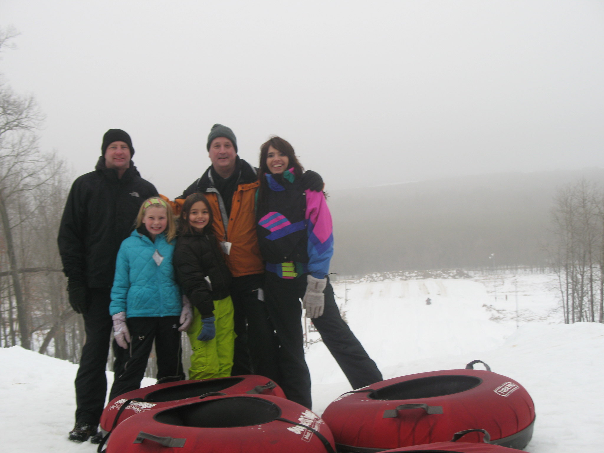 Family Tubing In Snow