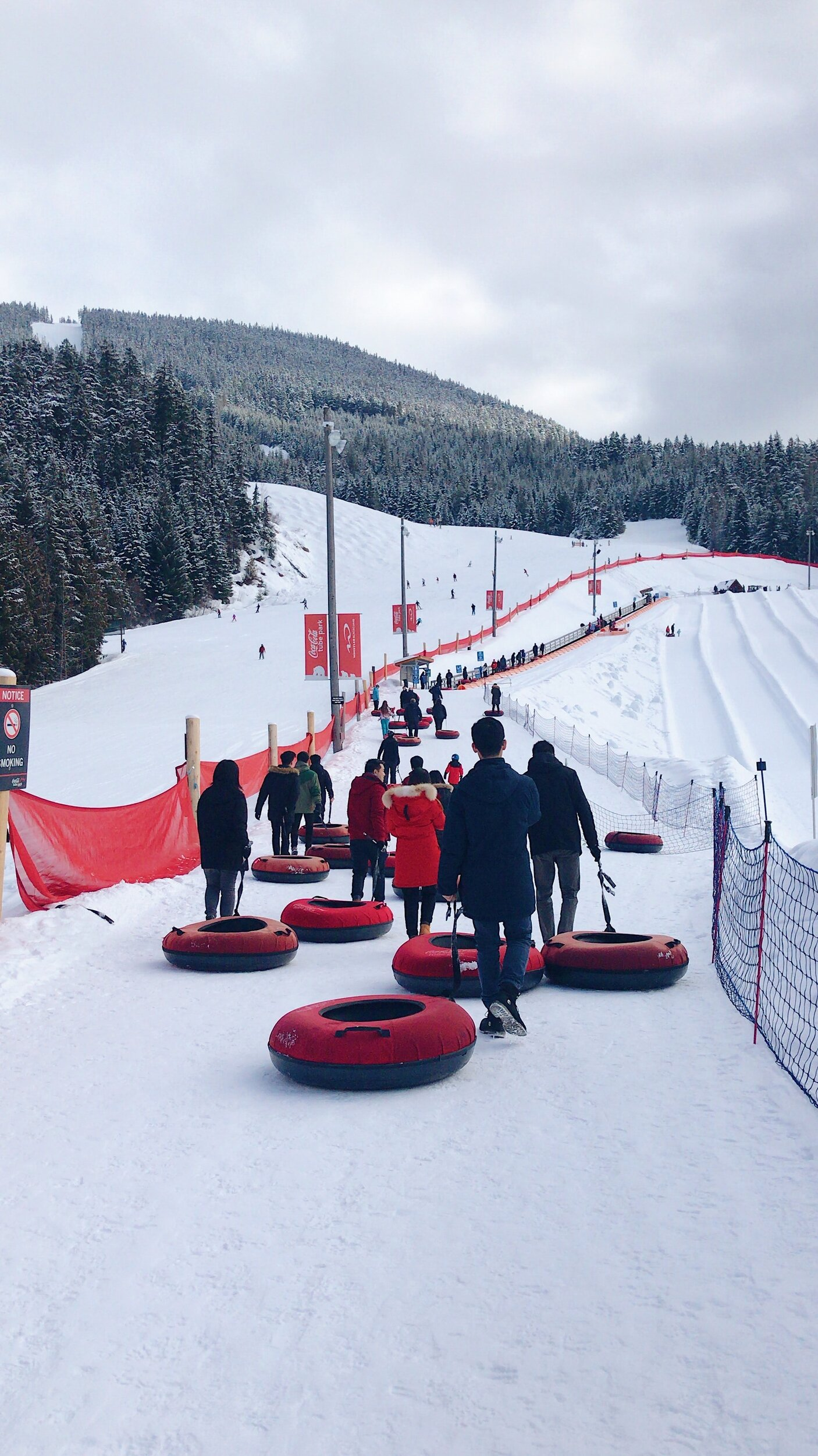 People tubing in the snow