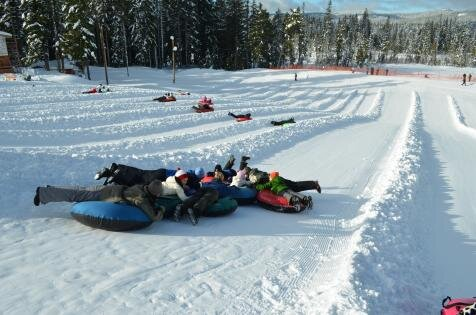 People tubing on snow